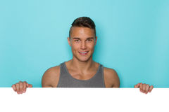 Smiling Handsome Man Behind White Placard Stock Images