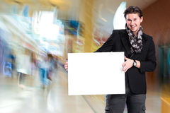 Smiling handsome man with big blank board Royalty Free Stock Photos