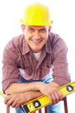 Smiling handsome man-builder stock image