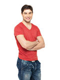 Smiling handsome man in casuals red t-shirt Royalty Free Stock Image