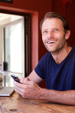 Smiling handsome man with cell phone. Portrait of smiling handsome man with cell phone Stock Images