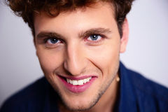 Smiling handsome man. Closeup portrait of a smiling handsome man Royalty Free Stock Image