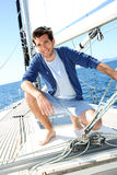 Smiling handsome man enjoying sailing Stock Photo