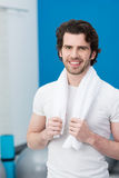 Smiling handsome man at the gym Stock Images