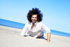 Smiling handsome man happy on tropical beach Royalty Free Stock Photography