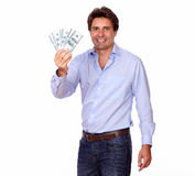 Smiling handsome man holding cash dollars Royalty Free Stock Image