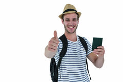 Smiling handsome man holding a leather wallet and showing thumbs up Royalty Free Stock Photos