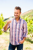 Smiling handsome man holding wineglass Stock Images