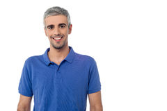 Smiling handsome man isolated over white. Portrait of casual young guy, studio shot Stock Images