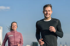 Smiling handsome man jogging with his wife Royalty Free Stock Photos