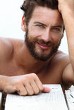 Smiling Handsome Man with No Shirt Royalty Free Stock Photos
