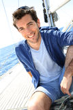 Smiling handsome man on a sailing boat Stock Photo
