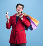 Smiling handsome man with shopping bags and credit card Stock Images