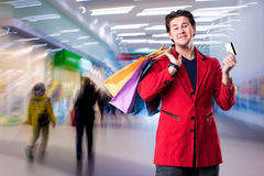 Smiling handsome man with shopping bags and credit card Royalty Free Stock Image
