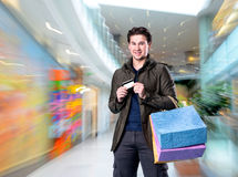 Smiling handsome man with shopping bags and credit card Stock Photo