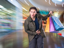 Smiling handsome man with shopping bags Royalty Free Stock Image