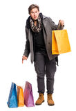 Smiling handsome man with shopping bags Stock Images