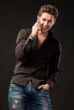Smiling handsome man with smartphone Royalty Free Stock Photo