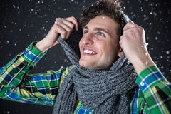 Smiling handsome man with snow Royalty Free Stock Images