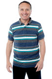 Smiling handsome man standing. Portrait of glad man over white background Stock Photo