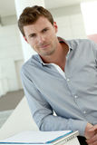 Smiling handsome man waiting in hall Royalty Free Stock Photo