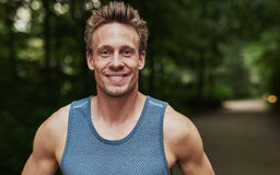 Smiling handsome muscular young man Royalty Free Stock Photos