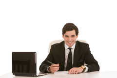 Businessman writing at his desk Royalty Free Stock Photography