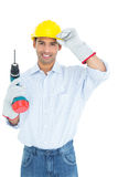 Smiling handsome young handyman in hard had with drill Stock Photos