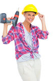 Smiling handy woman holding a power drill Stock Images