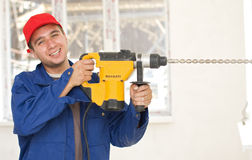 Smiling Handyman With Big Drill Royalty Free Stock Photography
