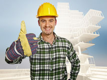 Smiling handyman and building Royalty Free Stock Photography