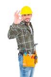 Smiling handyman gesturing okay Royalty Free Stock Photo