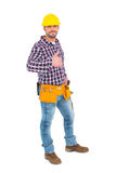 Smiling handyman gesturing thumbs up. On white background Stock Image