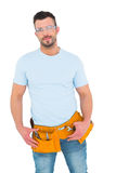 Smiling handyman with hands on hips. On white background Royalty Free Stock Photography