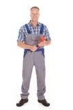 Smiling handyman holding adjustable wrench Stock Images