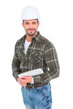 Smiling handyman holding a clipboard Royalty Free Stock Photo