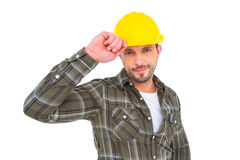 Smiling Handyman holding helmet Stock Image