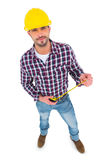 Smiling handyman holding tape measure Royalty Free Stock Photography