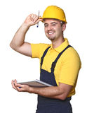 Smiling handyman with notebook Royalty Free Stock Photo