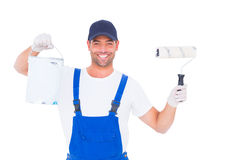 Smiling handyman with paint can and roller Royalty Free Stock Photo