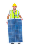 Smiling handyman with solar panel Stock Photography
