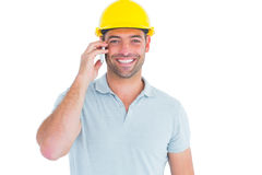 Smiling handyman talking on mobile phone Royalty Free Stock Photo