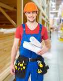 Smiling handyman with tools and paper Royalty Free Stock Images