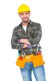 Smiling handyman wearing tool belt Royalty Free Stock Photo
