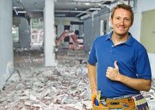 Smiling handyman at work Royalty Free Stock Images