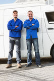Smiling handymen looking at camera Royalty Free Stock Image
