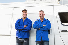 Smiling handymen looking at camera Royalty Free Stock Photo