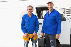 Smiling handymen looking at camera Stock Image