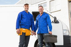 Smiling handymen looking at camera Stock Photos