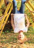 Smiling hanging girl Stock Images